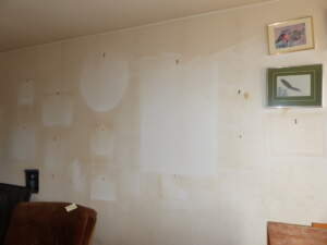 Telltale signs of a smoker—yellowed walls and the shadows of former pictures